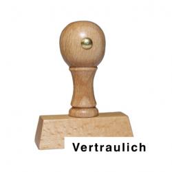 Holzstempel mit Text: Vertraulich