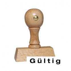 Holzstempel mit Text: Gültig